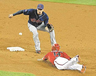 Arizona Diamondbacks' Ryan Roberts (14) steals second base as Cleveland Indians' Asdrubal Cabrera waits for the ball during the second inning in an interleague baseball game on Wednesday, June 29, 2011, in Phoenix. (AP Photo/Ross D. Franklin)