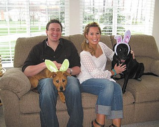 "Steve and Cathy Ferenchak of Canfield sent this picture of their two ""grandpups."" Their daughter, Angie Ferenchak of Westlake, adopted Cali (the black Lab ) from a shelter three years ago and little Yashu (the brown Chow ) this year. Joining in on their Easter fun is Angie's boyfriend, John Bialowas, also of Westlake."