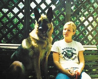Greta was found laying on the side of the road in Cleveland, and Gary and Ann Duracky of Poland got her through German Shepherd Rescue at a shelter when she was about 1 1/2. She is now 10 years old. She loves to swing and is pictured here with their daughter Beth.