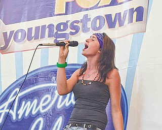 "Kerstin Williams, 16, of Warren performs ""Call Me When You're Sober"" by Evanescence at Eastwood Mall. About 100 performed to gain a spot at the ""American Idol"" Pittsburgh competition."