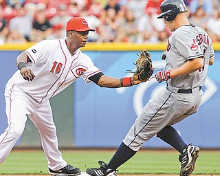 Cincinnati Reds shortstop Edgar Renteria (16) makes the out on Cleveland Indians' Justin Masterson at second base in the third inning of an interleague baseball game on Friday, July 1, 2011, in Cincinnati. Masterson was out on a fielder's choice hit into by Michael Brantley. (AP Photo/Al Behrman)