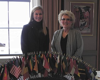 Dr. Cynthia Anderson, right, president of Youngstown State University, spoke at a Youngstown Lions Club meeting recently at the Youngstown Club. Dr. Anderson said YSU's biggest challenge is coping with continual cuts in state funding. She also expressed excitement about the many improvements at YSU, including the new Williamson School of Business and the indoor sports facility. At the same meeting, Jen Preisse, at left, was inducted into the club.