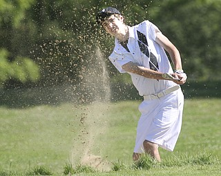 ROBERT K. YOSAY | THE VINDICATOR..Brandon Pluchinsky - works his way out of a trap on the number 10 hole at Diamond Back Golf Course - The areaÕs best youth golfers hit the links Tuesday, trying to make a name for themselves and collect the scholarship that comes along with the success.. the kickoff to the first ÒGreatest Junior Golfer in the ValleyÓ tournament, and the first ball will be launched off the tees of the Diamond Back Golf Course in Canfield. Throughout the month, golfers under the age of 18 as of Aug. 31 will attempt to qualify and be named the best...-30-