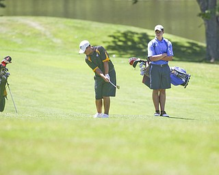 "ROBERT K. YOSAY | THE VINDICATOR..Cory Stefanec chips his shot on the 13th as  as Matt May looks on - The area's best youth golfers hit the links Tuesday, trying to make a name for themselves and collect the scholarship that comes along with the success.. the kickoff to the first ""Greatest Junior Golfer in the Valley"" tournament, and the first ball will be launched off the tees of the Diamond Back Golf Course in Canfield. Throughout the month, golfers under the age of 18 as of Aug. 31 will attempt to qualify and be named the best...-30-"