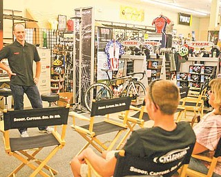 North Lima native and pro cyclist David Wenger speaks with Salem resident and beginner cyclist Chase Howard, 16, at Cycle Sales in Boardman. Wenger, who won the USA Cycling's 2011 Elite National Championship Criterium event in Augusta, Ga., will race in this weekend's Tour of the Valley. Howard, who has been racing for about a year, said getting to meet Wenger keeps him inspired.