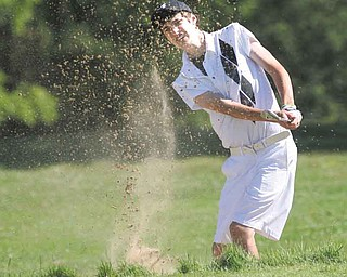 Brandon Pluchinsky, 17, works his way out of a sand trap on the No. 10 hole of Diamond Back Golf Course in Canfi eld on Tuesday during the fi rst qualifying round for the inaugural Greatest Junior Golfer of the Valley golf tournament. Eight golfers — four boys and four girls — made the cut to advance to the championship round, which will be played July 31 at Trumbull Country Club. Pluchinsky, a student at South Range High School, led the boys with a two-over 74.