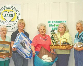 Volunteers for the Alzheimer's Network benefit garage sale are, from left to right, Mary Erb, Mary Kay Kollat, Carmella Guy, Dorothy Barto (director) and Dorothy Leone.