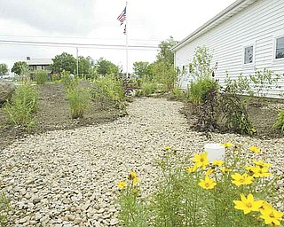A new rain garden installed at the Mill Creek MetroParks Farm in Canfield was funded through a $10,850 surface-water improvement grant from the Ohio Environmental Protection Agency. MetroParks received the grant in May 2010.