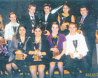 A remarkable year! More than 100 trophies were awarded to area piano, violin and vocal students at the Ohio Federation of Music Clubs District IB Festival recently. One 90-point cup, three 75-point cups and eight 60-point cups were given at the awards ceremony after the honors recital that day. In the front row, from left to right, are Amanda Ellis and Nicole Noday, 75-point cups, DiDomenico Studio; and Eva Laino, 90-point cup, and Jared Laino, 75-point cup, Rhinehart Studio. In the back row are 60-point cup recipients Lindsay Olsen, Hayley Ward and Michael Pallotta, DiDomenico Studio; Josiah Keener, Treble Clef Club; Arianna Ellis, DiDomenico Studio; Stephen DiPaolo, Rhinehart Studio; and Aylin Sarac, DiDomenico. Absent from the photo is Marie Adams, 60-point cup, DiDomenico.