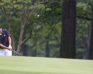 ROBERT K. YOSAY | THE VINDICATOR..winning chipper -  Dominic Patella  chips as Adam Bouch looks on.. - 16th hole - The Second Round of qualifiers for the  Best Jr. Golfer was held at Tamer Win in Cortland on Friday morning - .. ...-30-