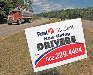 A sign looking to hire drivers, is placed on a roadway in Berlin, Vt. on Thursday, July 7, 2011. Unemployment rises to 9.2 pct. in June, employers add only 18,000 jobs. (AP Photo/Toby Talbot)