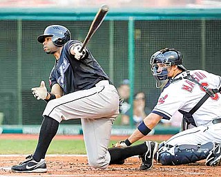 Toronto Blue Jays' Rajai Davis, left, hits a two-RBI single against Cleveland Indians starting pitcher Mitch Talbot during the second inning of a baseball game in Cleveland on Friday, July 8, 2011. Behind the plate is Cleveland Indians catcher Lou Marson. (AP Photo/Amy Sancetta)