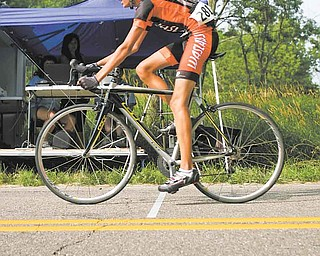 JESSICA M. KANALAS | THE VINDICATOR..Cyclist Daniel Lausin finishes his time trial for the Tour of the Valley at the Mastropietro Winery Inc. in Ellsworth. The Tour of the Valley features about 300 pro and amateur racers with the course running across the Mahoning Valley, through Columbiana, Ellsworth and Youngstown...-30-