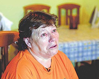 n this  Tuesday July 5, 2011 photo Inma Rodriguez holds back tears during an interview with The Associated Press in her home in Alcala de Henares near Madrid. Inma is packing for a trip she dreads. Any day now, for defaulting on her mortgage, she'll be evicted from the apartment where she's lived for 30 years and raised two children. As in many European countries, Spanish mortgages are not like US-style ones in which defaulters can return the keys to the bank and walk away from their debt, albeit with their credit rating in ruins. Here, mortgage holders not only have to give the house back, but also pay off bank debt. If they cannot, upon their death it is passed on to their children. (AP Photo/Paul White)