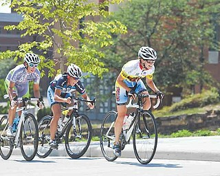 Jane Weekly pulls ahead in the last lap to win the women's criterium during Sunday's Tour of the Valley race at YSU. Christine Schryver was the overall winner of the event.