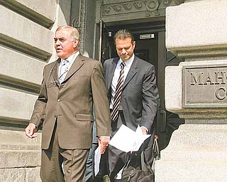 Anthony M. Cafaro Sr., former president of the Cafaro Co., center, emerges from the courthouse with a prepared statement to read to the media. He read the statement Monday after dismissal of all charges against him in the Oakhill Renaissance Place criminal conspiracy case. He is flanked by his lawyers, Martin G. Weinberg of Boston, left, and George A. Stamboulidis of New York City.