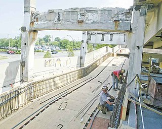 Work continues on the Youngstown State University parking deck on Lincoln Avenue. Plans are for renovation of the 1971 structure to be finished in time for the start of fall classes Aug. 29.
