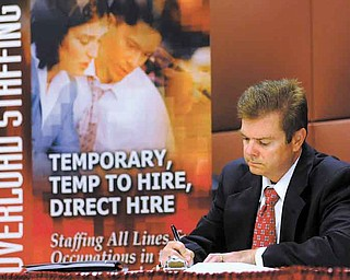Unemployed electrical engineer William Love of Pasadena, Md., whose unemployment benefi ts have been exhausted, fi lls out an application for a sales position at a job fair in Linthicum, Md. The number of job postings didn't increase in May, a sign that hiring is unlikely to pick up this summer.