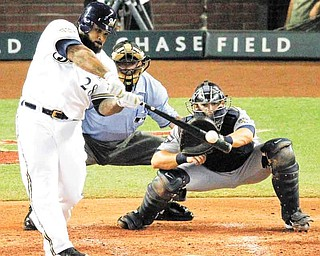 National League's Prince Fielder of the Milwaukee Brewers hits a three-run home run during the fourht inning of the MLB All-Star baseball game Tuesday, July 12, 2011, in Phoenix. (AP Photo/Ross D. Franklin)