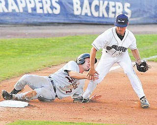 Mahoning Scrappers third baseman KC Serna hangs on to the ball as Connecticut Tigers baserunner Colin Kaline tries to take him out with a slide during their New York-Penn League baseball game Thursday at Eastwood Field in Niles. The Scrappers rallied from a four-run defi cit, scoring five runs in the sixth inning and going on to defeat the Tigers, 9-6.
