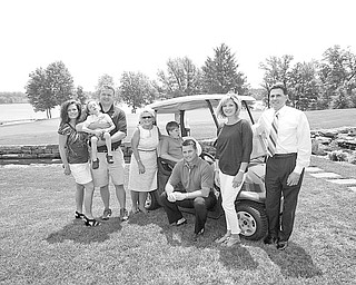 Among those involved with this year's PAR Golf Outing, scheduled for Aug. 29 at The Lake Club in Poland, are, from left to right, honorary chairs Melinda and Eric Wolford, holding their son Stone, and Dr. Cynthia Anderson; co-chairs Dominic (seated) and Jacqueline Marchionda, whose son Christopher is seated in the golf cart; and Chris Colella, a committee member.