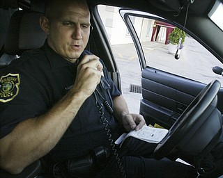 William D. Lewis The Vindicator   Boardman PD PTLM John Gocala in his cruiser while patrolling 7-6-11.