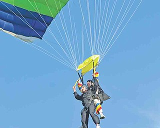 Michael Notar and his tandem partner/skydiving instructor, Paul Washak, parachute to the ground.