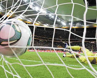 United States goalkeeper Hope Solo cannot stop what would be the game-winning shot by Japan's Saki Kumagai during the penalty shootout of Women's World Cup Soccer final Sunday in Frankfurt, Germany. The teams were tied 2-2 until the penalty phase, which the Japanese won 3-1.