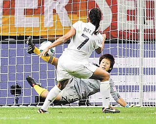 Japan goalkeeper Ayumi Kaihori stops a shot by the United States' Shannon Boxx during the penalty shootout.