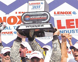Ryan Newman celebrates his victory in the NASCAR Sprint Cup Series auto race at New Hampshire Motor Speedway on Sunday, July 17, 2011, in Loudon, N.H. (AP Photo/Toby Talbot)
