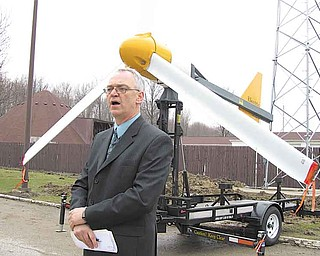 Lordstown Mayor Michael Chaffee stands in front of one of the village's previously installed wind turbines. Through more than three months of operation, there are questions as to exactly how much money the turbines have saved the village.