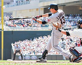 Cleveland Indians' Asdrubal Cabrera hits a three-run home run off Minnesota Twins pitcher Anthony Swarzak in the third inning of the first baseball game of a doubleheader Monday, July 18, 2011 in Minneapolis. Catching is Twins' Drew Butera. (AP Photo/Jim Mone)