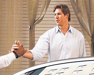 Cleveland Browns linebacker Scott Fujita leaves the NFL Players Association, Wednesday, July 20, 2011, in Washington, as talks to end the NFL lockout continued. (AP Photo/Jacquelyn Martin)