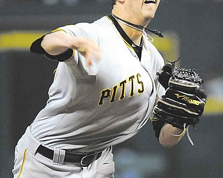 Pittsburgh Pirates' Jeff Karstens delivers a pitch in the eighth inning of a baseball game against the Houston Astros, Friday, July 15, 2011, in Houston. Karstens pitched a complete game as the Pirates beat the Astros 4-0. (AP Photo/Pat Sullivan)