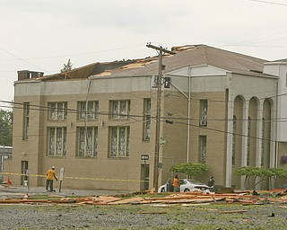 ROBERT K. YOSAY | THE VINDICATOR..- Mt Calvary Church on Oak Hill suffered severe damage as the roof  was ripped off and landed across  Oak Hill in a vacant lot -  firefighters did not think anyone was injured - A late afternoon summer thunderstorm hit the southside of Youngstown - taking down limbs, trees and knocking out electric -  the RIBFEST at the Covelli Centre had several people injured when tents were blown down ...-30-