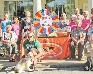 The committee for the 2011 ROCC and Rescue Reverse Raffle comprises, from left to right in front, Nate Johnson with Holly, a victim of severe neglect, and Scott Snyder with Judge. In the second row are Atty. Amanda Jackson, Atty. Barb Plummer, and Dessie and Bob Bates, and in the back are Dylan Paumier, Nickole Davis, Darla Miller, JayDee Pamer, Lisa Shoff, Sally Geary, Carey Shoff, Darlene Jenkins, Jenny Pike and Lora Herbert. Missing from the photo are Dr. Vickey Brooks, Lisa Keller and Heather Jurina.