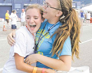 Megan Frantz, left, hugs her friend, Ashley Hiller after Frantz won the Masters championship race at the 74th All-American Soap Box Derby Saturday, July 23, 2011, in Akron, Ohio. Frantz, 16,  is from New Philadelphia, Ohio. (AP Photo/Tony Dejak)