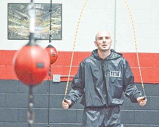 Kelly Pavlik works out at the South Side Boxing Club with trainer Jack Loew in Youngstown on July 20, 2011.