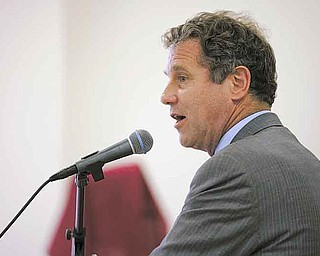 U.S. Sen. Sherrod Brown speaks to community members during Sunday's town-hall meeting at the Union Baptist Church in Youngstown. The meeting discussed the impact of possible cuts to Social Security, Medicare and Medicaid.