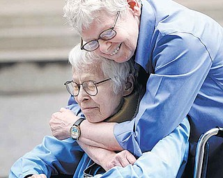 Phyllis Siegel, 77, left, and Connie Kopelov, 85, both of New York, embrace after becoming the first same-sex couple to get married at the Manhattan City Clerk's office, Sunday, July 24, 2011, in New York.