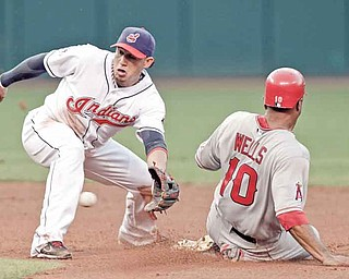 Los Angeles Angels' Vernon Wells (10) steals second base as Cleveland Indians shortstop Asdrubal Cabrera takes a throw in the fourth inning of a baseball game Monday, July 25, 2011, in Cleveland. (AP Photo/Mark Duncan)