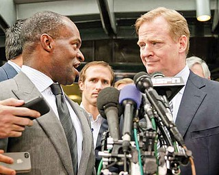 NFLPA Executive Director DeMaurice Smith, left, and NFL football Commissioner Roger Goodell take part in a news conference Monday at the NFL Players Association in Washington, after the NFLPA executive board and 32 team reps voted unanimously to approve the terms of a deal with owners to the end the four-month lockout.