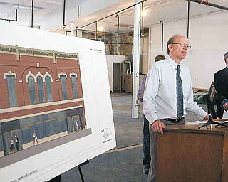 The Raymond John Wean Foundation had a news conference Monday to display drawings and plans to be carried out by The Chesler Group of Cleveland to renovate 147 W. Market St. in Warren. Gordon Wean presented an artist rendering of the finished building.