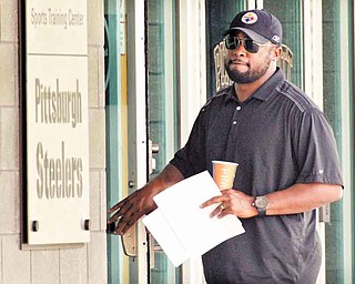 Pittsburgh Steelers coach Mike Tomlin arrives at the NFL football team's training facility in Pittsburgh on Tuesday, July 26, 2011. (AP Photo/Gene J. Puskar)