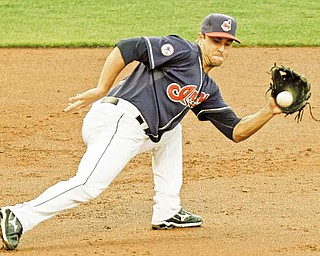 Cleveland Indians third baseman Jack Hannahan tracks down a ground ball by Los Angeles Angels' Jeff Mathis during the third inning of a baseball game, Tuesday, July 26, 2011, in Cleveland. Hannahan threw Mathis out at first. (AP Photo/Mark Duncan)