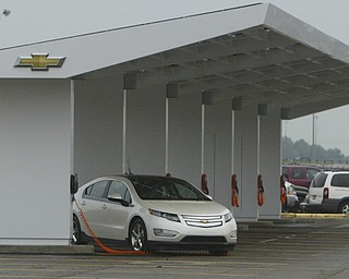 ROBERT  K.  YOSAY  | THE VINDICATOR --..A loan volt sits at the newly constructed solar charging station at GM Lordstown ..The Lordstown Complex is a General Motors automobile factory in Lordstown, Ohio comprising three facilities: Vehicle Assembly, Metal Center, and Paint Shop. The plant opened in 1966. Lordstown currently builds the global Chevrolet Cruze compact car.The plant welcomed over 9000 visitors to view the  Metal Center ( west plant) and the asembly plant on Thursday.--30-..(AP Photo/The Vindicator, Robert K. Yosay)