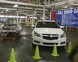 ROBERT  K.  YOSAY  | THE VINDICATOR --..From Frame to Finished product The Cruze is an Ohio Product..The Lordstown Complex is a General Motors automobile factory in Lordstown, Ohio comprising three facilities: Vehicle Assembly, Metal Center, and Paint Shop. The plant opened in 1966. Lordstown currently builds the global Chevrolet Cruze compact car.The plant welcomed over 9000 visitors to view the  Metal Center ( west plant) and the asembly plant on Thursday.--30-..(AP Photo/The Vindicator, Robert K. Yosay)