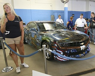 ROBERT  K.  YOSAY  | THE VINDICATOR --..Also on display was the hand painted American Pride Camaro which shows various scenes related to Americas fight for freedom..The Lordstown Complex is a General Motors automobile factory in Lordstown, Ohio comprising three facilities: Vehicle Assembly, Metal Center, and Paint Shop. The plant opened in 1966. Lordstown currently builds the global Chevrolet Cruze compact car.The plant welcomed over 9000 visitors to view the  Metal Center ( west plant) and the asembly plant on Thursday.--30-..(AP Photo/The Vindicator, Robert K. Yosay)