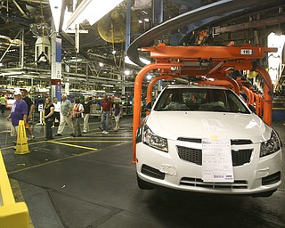 ROBERT  K.  YOSAY  | THE VINDICATOR --..Touring the facility.The Lordstown Complex is a General Motors automobile factory in Lordstown, Ohio comprising three facilities: Vehicle Assembly, Metal Center, and Paint Shop. The plant opened in 1966. Lordstown currently builds the global Chevrolet Cruze compact car.The plant welcomed over 9000 visitors to view the  Metal Center ( west plant) and the asembly plant on Thursday.--30-..(AP Photo/The Vindicator, Robert K. Yosay)