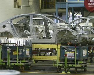 ROBERT  K.  YOSAY  | THE VINDICATOR --..Frames of Cruze's lined up read for the doors and hoods and trunks to be installed..The Lordstown Complex is a General Motors automobile factory in Lordstown, Ohio comprising three facilities: Vehicle Assembly, Metal Center, and Paint Shop. The plant opened in 1966. Lordstown currently builds the global Chevrolet Cruze compact car.The plant welcomed over 9000 visitors to view the  Metal Center ( west plant) and the asembly plant on Thursday.--30-..(AP Photo/The Vindicator, Robert K. Yosay)